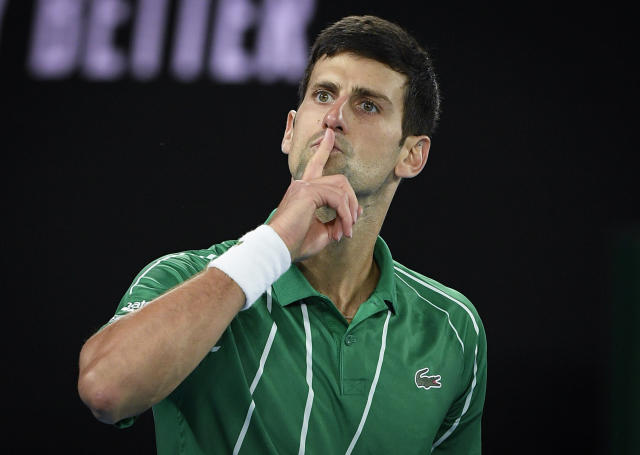 Serbia's Novak Djokovic celebrates after defeating Austria's Dominic Thiem in the final of the Australian Open tennis championship in Melbourne, Australia, Sunday, Feb. 2, 2020. (AP Photo/Andy Brownbill)