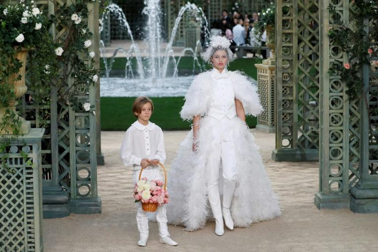 Amid all the frills and feathers, the bride -- the figure that traditionally closes Paris haute couture shows -- wore trousers