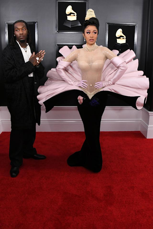 <p>Cardi B made the biggest statement of all with her black, pink and nude peacock like dress, paired with an interesting headpiece. </p>