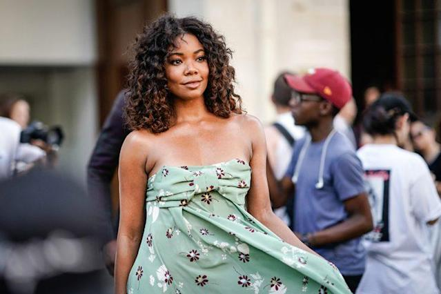 Gabrielle Union was spotted in Paris with glowing skin and voluminous curls. (Photo: Getty Images)