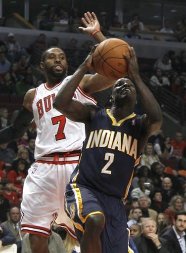 Indiana Pacers point guard Darren Collison (2) drives past Chicago Bulls point guard C.J. Watson, during the first half of an NBA preseason basketball game Tuesday, Dec. 20, 2011 in Chicago. (AP Photo/Charles Rex Arbogast)