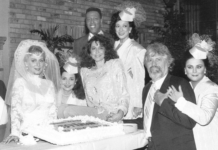 The cast, along with executive producers Linda Bloodworth-Thomason and Harry Thomason, attend Charlene's Season 3 wedding (Credit: CBS/Everett Collection)