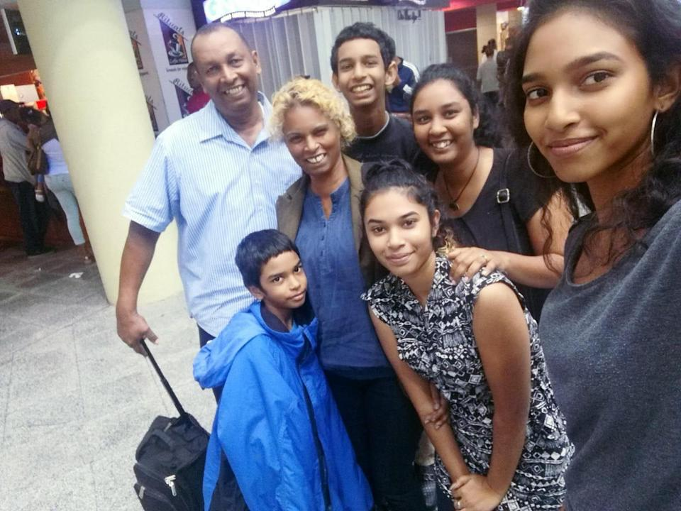 <p>Lynda Mahabir (second left) had hoped it would be a matter of months before her family would be able to join her when she left for the UK in October 2018 – but they are still apart</p> (Lynda Mahabir)
