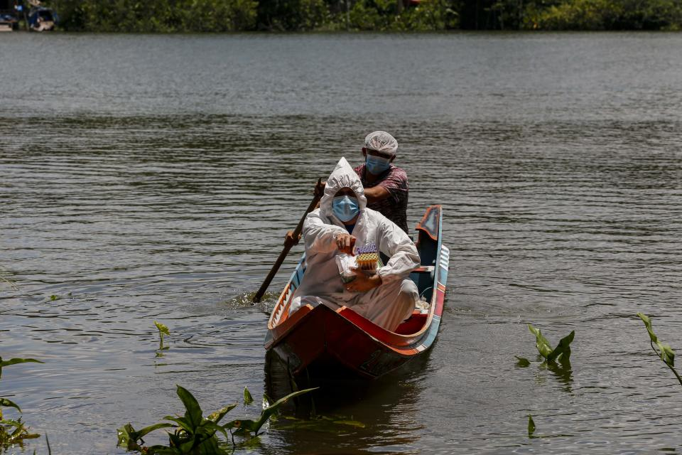 A Health sails at the Beira da Costa bay in the Igarape-Miri municipality, lower Tocantins region, northeast of Para state, Brazil on October 28, 2020. - The state of Para health department prepares to have a second coronavirus wave and increased the measures to prevent the spread of the COVID-19. Health authorities confirmed on Wednesday 956 more cases of Covid-19 and three deaths raisinfg the toll to 251,292 cases and 6,736 deaths in the state. (Photo by TARSO SARRAF / AFP) (Photo by TARSO SARRAF/AFP via Getty Images)