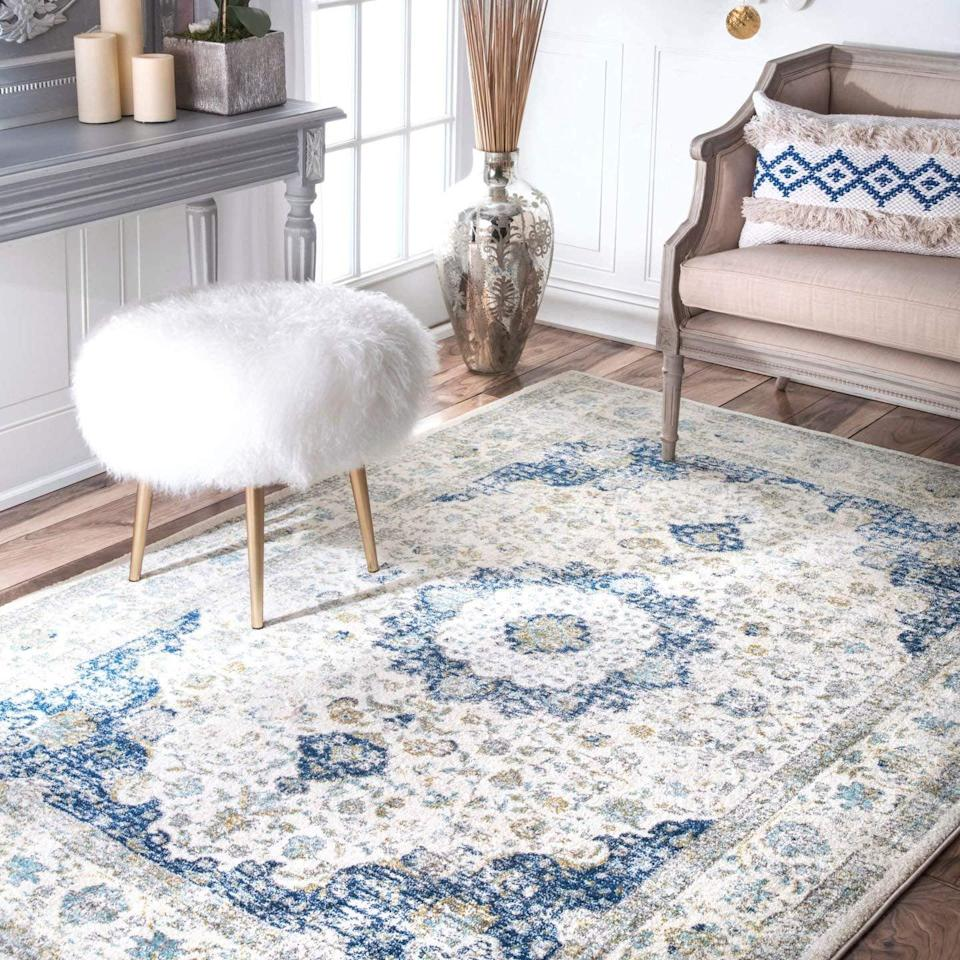 """<p>Instantly brighten up any space with this unique <a href=""""https://www.popsugar.com/buy/Nuloom-Vintage-Persian-Verona-Area-Rug-401613?p_name=Nuloom%20Vintage%20Persian%20Verona%20Area%20Rug&retailer=amazon.com&pid=401613&price=24&evar1=casa%3Aus&evar9=45784601&evar98=https%3A%2F%2Fwww.popsugar.com%2Fhome%2Fphoto-gallery%2F45784601%2Fimage%2F45784614%2FNuloom-Vintage-Persian-Verona-Area-Rug&list1=shopping%2Camazon%2Csmall%20space%20living%2Cproducts%20under%20%2450%2Cdecor%20inspiration%2Caffordable%20shopping%2Chome%20shopping&prop13=api&pdata=1"""" class=""""link rapid-noclick-resp"""" rel=""""nofollow noopener"""" target=""""_blank"""" data-ylk=""""slk:Nuloom Vintage Persian Verona Area Rug"""">Nuloom Vintage Persian Verona Area Rug</a> ($24-$49).</p>"""