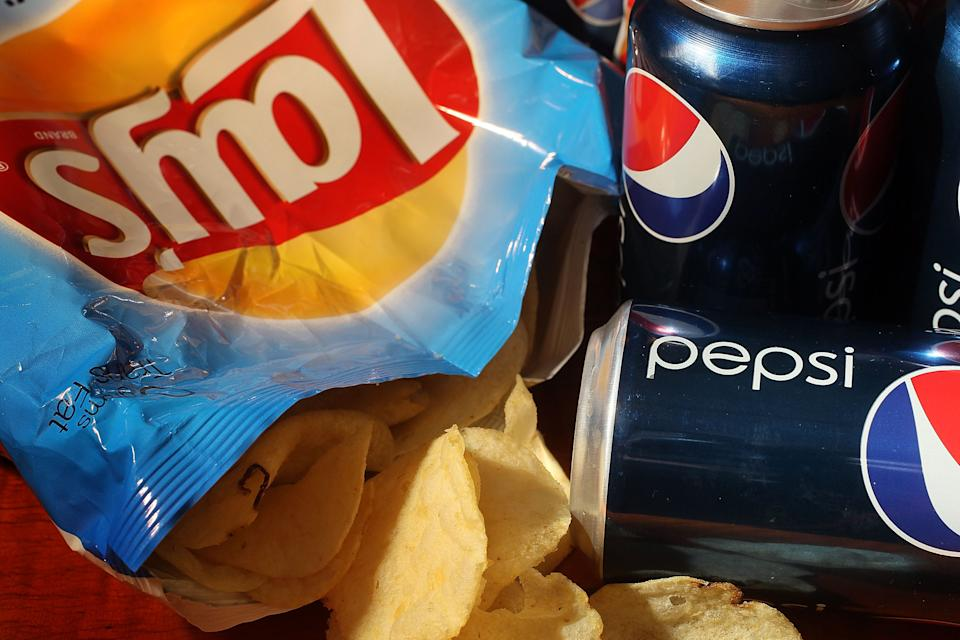 MIAMI - MARCH 22:  In this photo illustration a bag of chips maufactured by PepsiCo's Frito-Lay brand and cans of their Pepsi soda is seen on March 22, 2010 in Miami, Florida.  PepsiCo announced plans to cut sugar, fat, and sodium in its products to address health and nutrition concerns. The maker of soft drinks including Pepsi-Cola, Gatorade also makes Frito-Lay brand snacks.  (Photo Illustration by Joe Raedle/Getty Images)