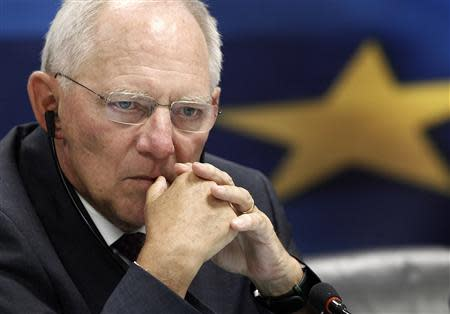 German Finance Minister Schaeuble listens to a news conference in the Greek ministry of finance in Athens
