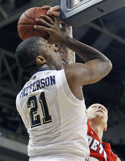 Pittsburgh's Lamar Patterson (21) has a shot blocked by Detroit's Nick Minnerath (34) in the first half of an NCAA college basketball game Saturday, Dec. 1, 2012, in Pittsburgh. (AP Photo/Keith Srakocic)