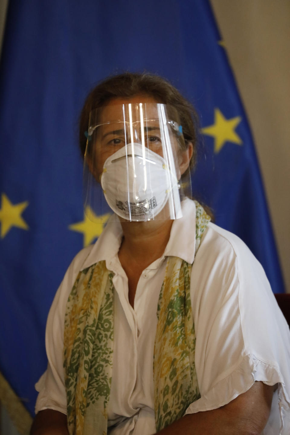 """European Union Ambassador to Venezuela Isabel Brilhante Pedrosa wears a mask and face shield amid the COVID-19 pandemic, as she meets with Venezuelan Foreign Minister Jorge Arreaza at his office in Caracas, Venezuela, Wednesday, Feb. 24, 2021. The meeting was called after the EU sanctioned an additional 19 Venezuelans for """"undermining democracy and the rule of law"""" in Venezuela and the National Assembly declared the EU ambassador """"persona non grata."""" (AP Photo/Ariana Cubillos)"""