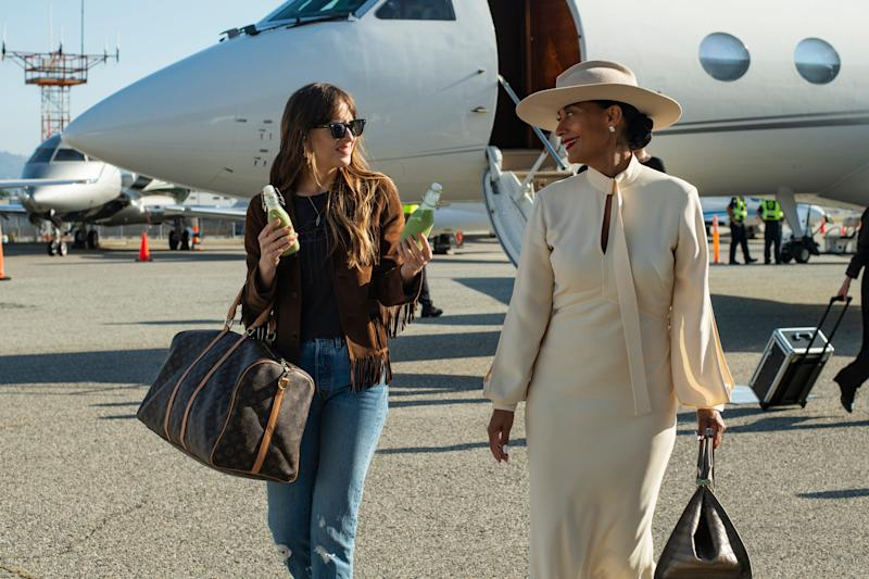 """Maggie Dakota Johnson, left) is the personal assistant of superstar diva Grace Davis (Tracee Ellis Ross) in """"The High Note."""""""