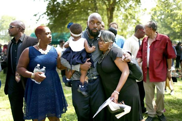 The father of Michael Brown, attending the funeral of his son who was killed by a police officer (AFP Photo/JOE RAEDLE)