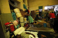 A woman shelves a foam mattress as she tides up her area at a shelter for displaced Haitians, in Port-au-Prince, Haiti, Saturday, July 10, 2021, three days after Haitian President Jovenel Moise was assassinated in his home. The displaced Haitians were forced to flee their community where they had settled after the 2010 earthquake, after armed gangs set their homes on fire in late June. (AP Photo/Fernando Llano)