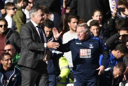 Britain Soccer Football - Chelsea v Crystal Palace - Premier League - Stamford Bridge - 1/4/17 Crystal Palace manager Sam Allardyce shakes hands with assistant manager Sammy Lee after the match Action Images via Reuters / Tony O'Brien Livepic