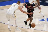 Toronto Raptors guard Jalen Harris (2) loses control of the ball as he's fouled by Dallas Mavericks' Kristaps Porzingis (6) in the second half of an NBA basketball game in Dallas, Friday, May 14, 2021. (AP Photo/Tony Gutierrez)