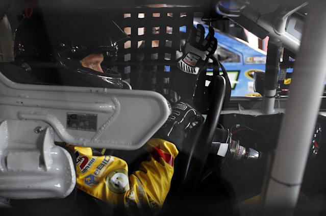 Josh Wise puts on his gloves as he prepares for practice for Sunday's Aaron's 499 NASCAR auto race at Talladega Superspeedway on Friday, May 2, 2014, in Talladega, Ala. (AP Images Photo/Butch Dill)