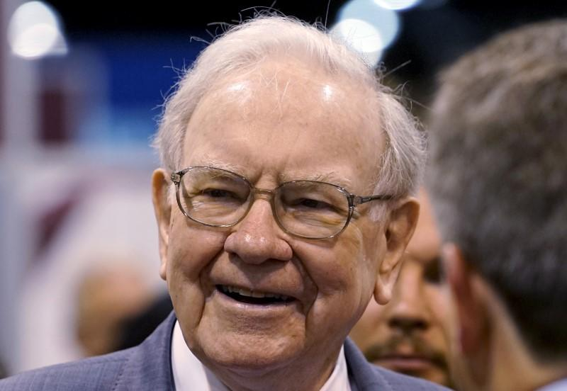Berkshire Hathaway CEO Warren Buffett talks to reporters prior to the Berkshire annual meeting in Omaha
