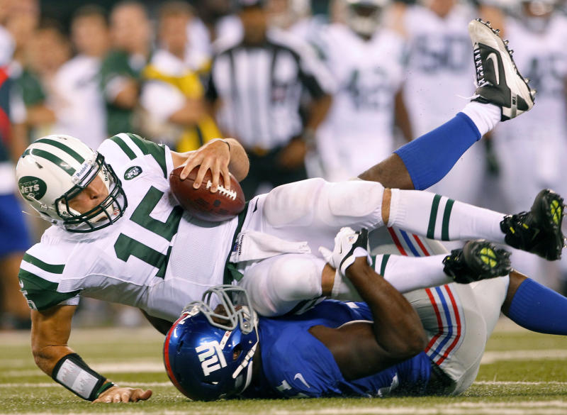 New York Jets quarterback Tim Tebow (15) is sacked by New York Giants defensive end Adewale Ojomo during the second half of a preseason NFL football game Saturday, Aug. 18, 2012, in East Rutherford, N.J. (AP Photo/Rich Schultz)