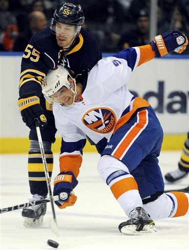 Buffalo Sabres forward Jochen Hecht (55), of Germany, knocks the puck away from New York Islanders forward Frans Nielsen (51), of Denmark, in the second period of their NHL hockey game, Saturday, Jan. 14, 2012, in Uniondale, N.Y. (AP Photo/John Dunn)