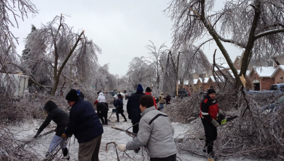 people cleaning up ice storm