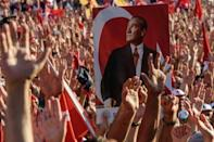 Turkey targets media after coup as Erdogan meets opposition