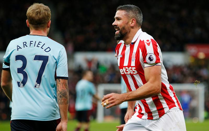 Jonathan Walters (R) is considering his future - Reuters
