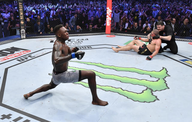 Israel Adesanya celebrates after his knockout victory over Robert Whittaker in their UFC middleweight championship fight during the UFC 243 event at Marvel Stadium on Oct. 6, 2019 in Melbourne, Australia. (Getty Images)
