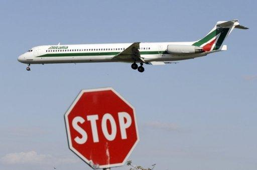 An Alitalia passenger plane lands at Linate airport in Milan, Italy on September 22, 2008