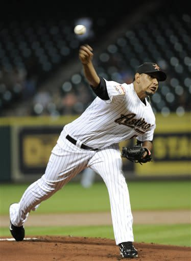 Houston Astros' Aneury Rodriguez delivers a pitch against the Miami Marlins in the first inning of a baseball game Tuesday, May 8, 2012, in Houston. (AP Photo/Pat Sullivan)