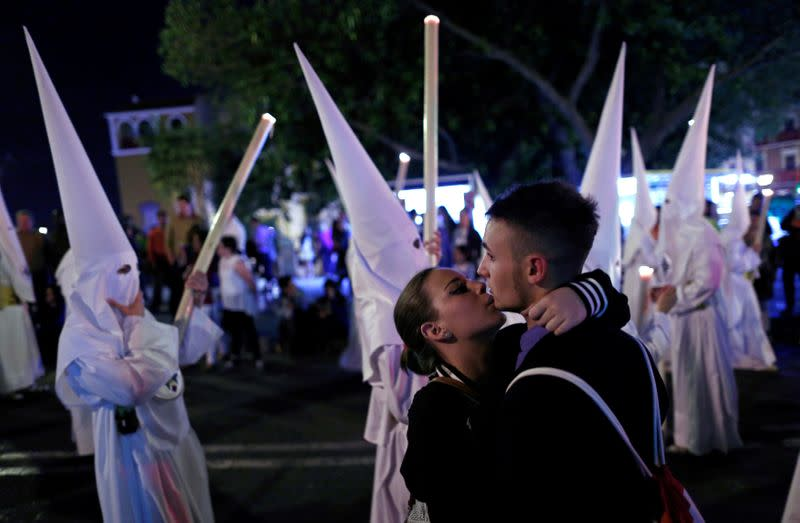 FILE PHOTO: A couple embrace next to the San Gonzalo procession during Holy Week in Seville