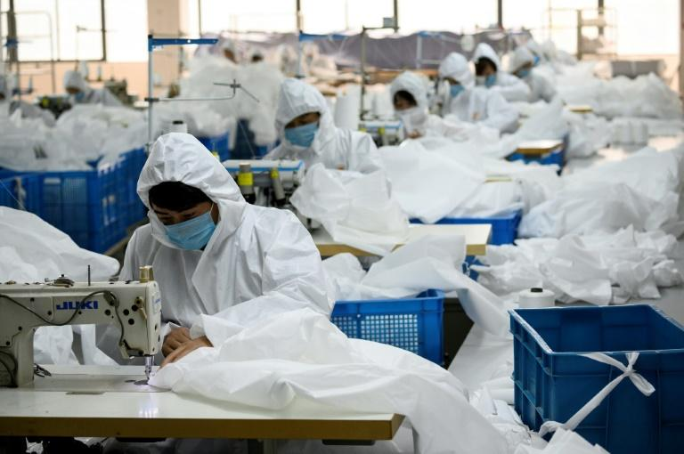 Ugly Duck Industry in Wenzhou, eastern China, has switched production from winter coats to hazmat suits