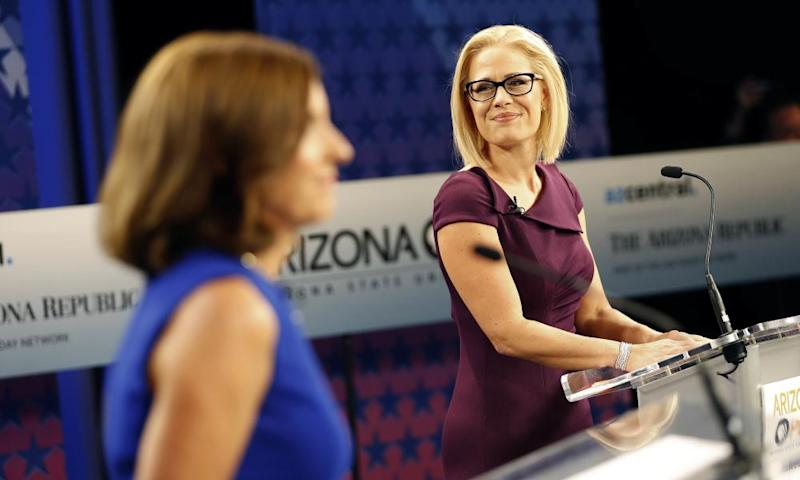 Martha McSally, left, who is running against Krysten Sinema, said she is getting her 'ass kicked' over her votes to scrap Obamacare.