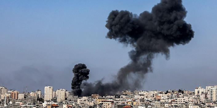 Smoke billows following Israeli airstrikes on Gaza City on May 12, 2021, amid the most intense Israeli-Palestinian hostilities in seven years.