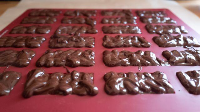 Photo of all the molds filled with chocolate and our Butterfinger filling