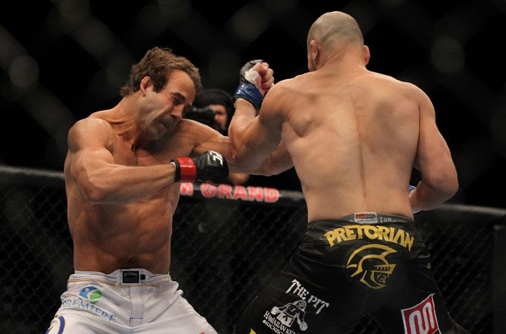 LAS VEGAS, NV - MAY 26:  Glover Teixeira (right) punches Kyle Kingsbury during a light heavyweight bout at UFC 146 at MGM Grand Garden Arena on May 26, 2012 in Las Vegas, Nevada.