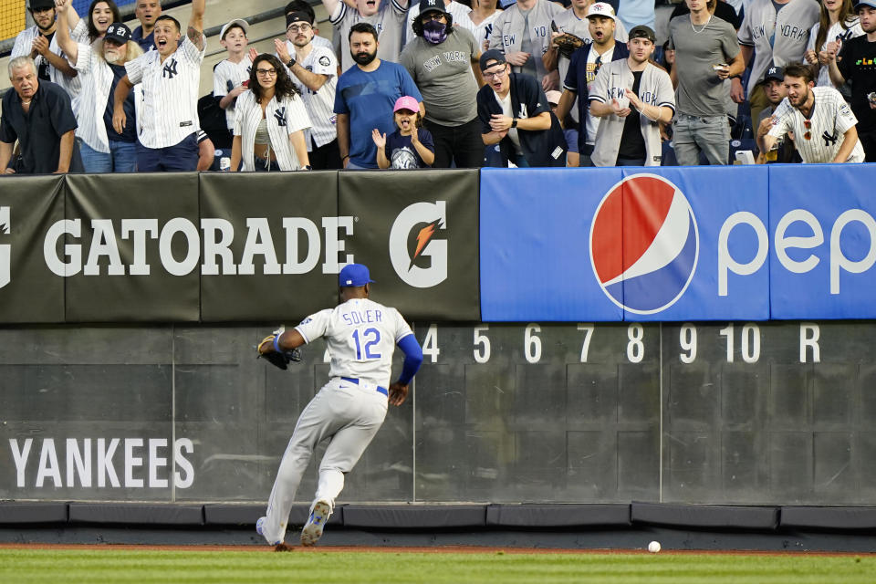 Kansas City Royals right fielder Jorge Soler (12) chases down Clint Frazier's two-run double during the fourth inning of a baseball game against the New York Yankees, Wednesday, June 23, 2021, at Yankee Stadium in New York. (AP Photo/Kathy Willens)
