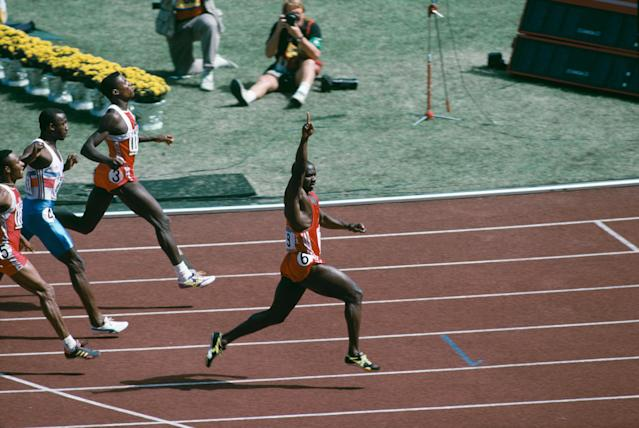 Canadian sprinter Ben Johnson wins the 100 metres final at the Seoul Olympics, 24th September 1988. However he was later disqualified when traces of anabolic steroid were found in his urine. American athlete Carl Lewis, who was subsequently awarded the gold medal, is also pictured. (Photo by Simon Bruty/Getty Images)