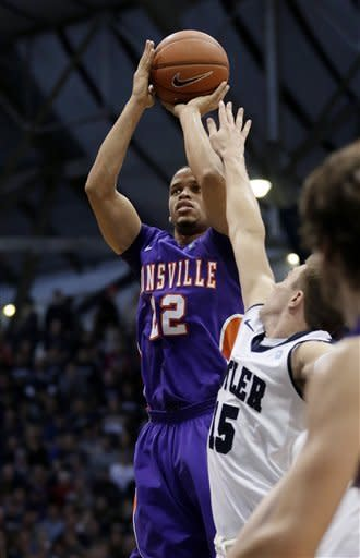 Evansville guard Ned Cox shoots over Butler guard Rotnei Clarke (15) during the second half of an NCAA college basketball game, Saturday, Dec. 22, 2012, in Indianapolis. Butler won 75-67. (AP Photo/AJ Mast)