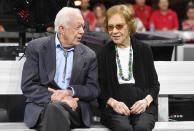 FILE - In this Sept. 30, 2018, file photo former President Jimmy Carter and Rosalynn Carter are seen ahead of an NFL football game between the Atlanta Falcons and the Cincinnati Bengals in Atlanta. Jimmy Carter and his wife Rosalynn celebrate their 75th anniversary this week on Thursday, July 7, 2021. (AP Photo/John Amis, File)