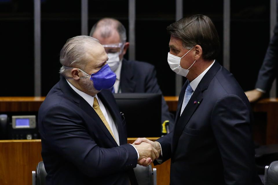 Brazil's President Jair Bolsonaro (R) shakes hands with Brazil's Prosecutor-General Augusto Aras during the opening session of the legislative year in Brasilia, on February 3, 2021. - The Brazilian Congress on Monday elected two allies of President Jair Bolsonaro to head the Senate and the lower house, an important victory for the far-right leader in his quest to reinvigorate his reelection efforts for 2022. (Photo by Sergio Lima / AFP) (Photo by SERGIO LIMA/AFP via Getty Images)
