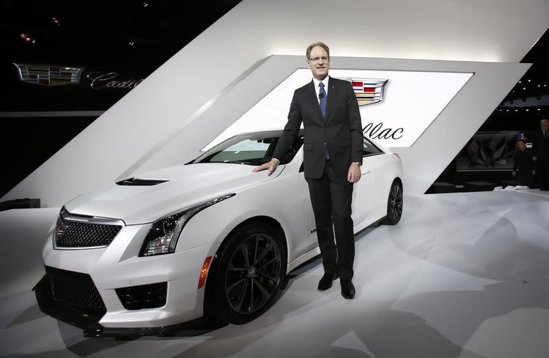 Cadillac President de Nysschen poses with the Cadillac ATS-V during the model's world debut at the Los Angeles Auto Show in Los Angeles