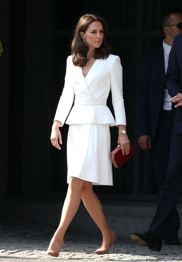 <p>For a trip to the Warsaw Museum in Poland, the Duchess of Cambridge opted for a peplum skirt suit by Alexander McQueen. <em>[Photo: Getty]</em> </p>