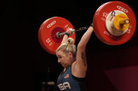 Katherine Elizabeth Nye of the United States competes in the women's 76kg weightlifting event, at the 2020 Summer Olympics, Sunday, Aug. 1, 2021, in Tokyo, Japan. (AP Photo/Luca Bruno)