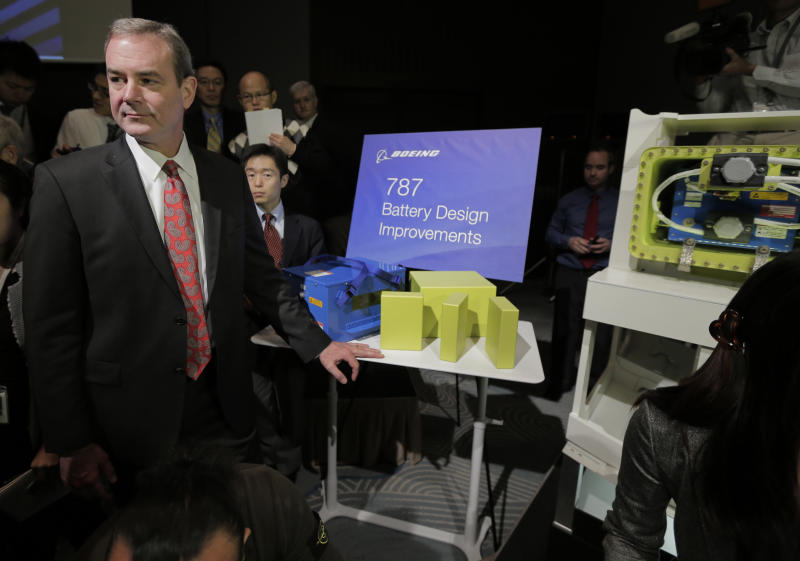 "Boeing Commercial Airplanes Vice President and Chief Project Engineer Mike Sinnett poses with a model of newly designed 787's battery during a news conference in Tokyo, Friday, March 15, 2013. Boeing executives said commercial flights of its grounded 787 jets will resume ""within weeks, not months"" with a third of safety tests already completed. They said Friday they had not pinpointed the causes of the two battery problems that resulted in the global grounding of the technologically advanced Dreamliner planes. (AP Photo/Itsuo Inouye)"