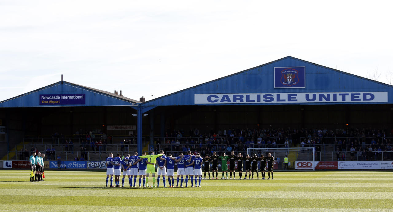 "Britain Football Soccer - Carlisle United v Crewe Alexandra - Sky Bet League Two - Brunton Park - 25/3/17 General view as a minutes silence is observed in respect for the victims of the London attack before the game Action Images via Reuters / Ed Sykes Livepic EDITORIAL USE ONLY. No use with unauthorized audio, video, data, fixture lists, club/league logos or ""live"" services. Online in-match use limited to 45 images, no video emulation. No use in betting, games or single club/league/player publications.  Please contact your account representative for further details."