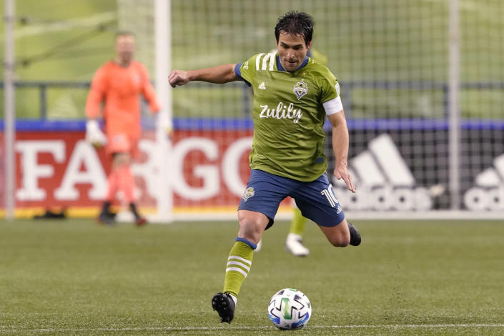 FILE - In this Tuesday, Nov. 24, 2020 file photo, Seattle Sounders midfielder Nicolas Lodeiro readies a kick during the first half of the team's MLS playoff soccer match against Los Angeles FC in Seattle. The Seattle Sounders are known for making the Major League Soccer postseason in each year of the club's existence. The team has also shown the ability to correctly assess when it needs to overhaul its personnel, whether it's bringing in an influx of fresh talent or giving younger players in the system a chance. That's the decision the Sounders made going into the 2021 season.(AP Photo/Ted S. Warren, File)