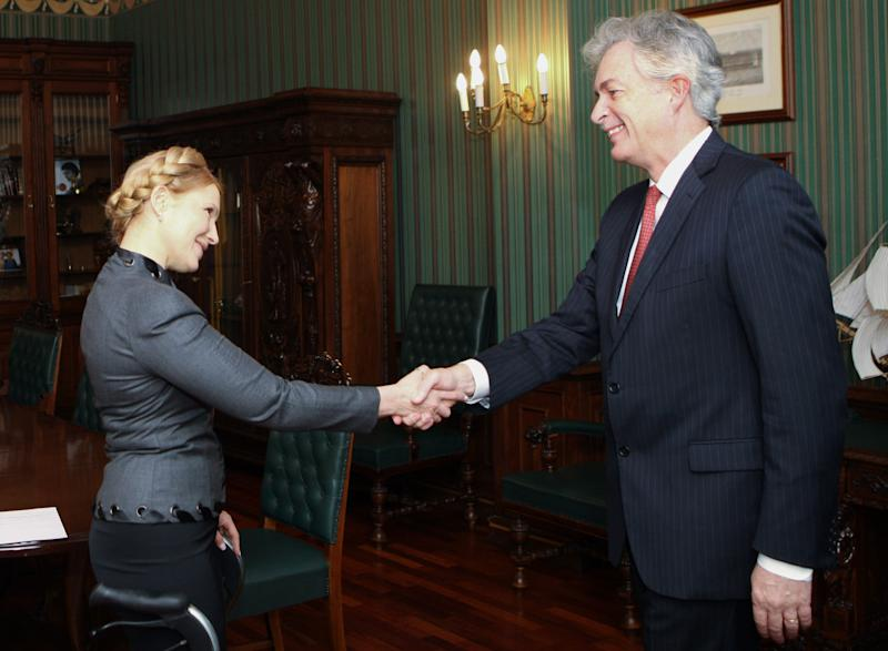 Former Ukrainian Prime Minister Yulia Tymoshenko shakes hands with US Deputy Secretary of State William Burns in Kiev, Ukraine, Wednesday Feb. 26, 2014. The campaign for Ukraine's early May 25 presidential election began Tuesday, with Yanukovych's archrival — former Prime Minister Yulia Tymoshenko — widely seen as a top contender for the post. (AP Photo/Pool)