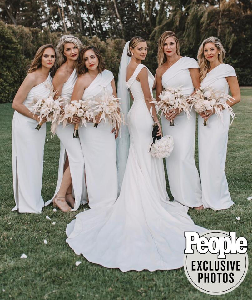 """Nel-Peters, 24, wore a custom gown from David's Bridal aftertrying on approximately 50 designs of different fits and silhouettes.  Nel-Peters —Miss Universe 2017 — """"ended up sticking with"""" a """"clean, sleek and elegant"""" off-the-shoulder fit-and-flare style that complemented the overall """"traditional and timeless"""" vibe of the wedding."""