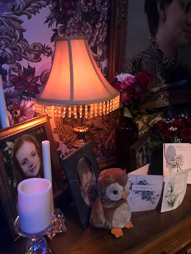 <p>Sympathy cards and pictures of deceased character Barb Holland at various ages were displayed in the character's memorial shrine.<br><br>(Photo: Yahoo) </p>