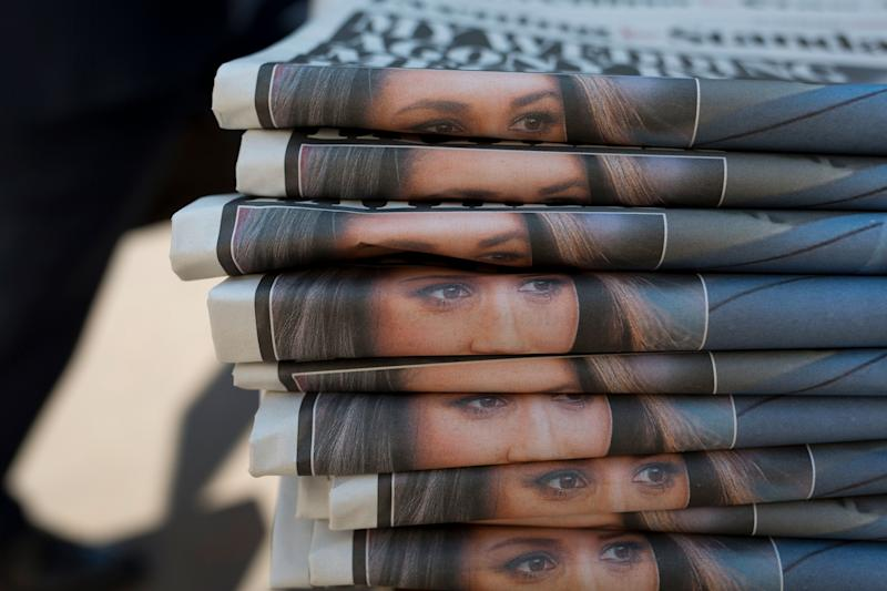 A stack of newspapers with Meghan Markle on them