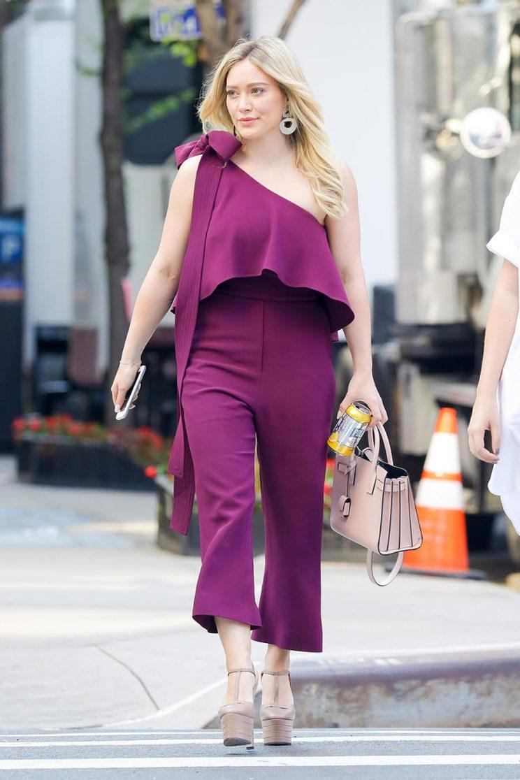 She ends the day in this enviable purple jumpsuit. (Photo: Splash)